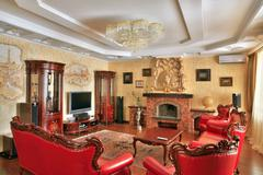 Drawing-room in golden and red colors interior in classic style, expensive fu Stock Photos