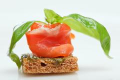 salmon canape with basil isolated on white - stock photo