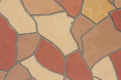 Irregular mosaic of wall outdoor Stock Photos