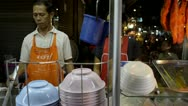 Street Vendor Making Noodle Soup with Grilled Pork (Bami Mu Daeng) Stock Footage