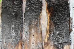 Old wooden background of the advice after fire Stock Photos