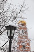 bell tower and streetlight. orthodox monastery davidova pustin in winter. che - stock photo