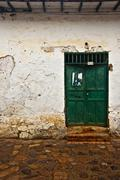 Old Colonial Wall with a Green Door Stock Photos