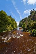 Beautiful brown vulcanic river Stock Photos