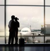 Sweethearts in airport Stock Photos