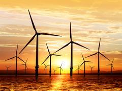 wind turbine on sunset - stock photo