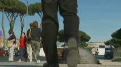 Italian policeman stops a begger in Rome Stock Footage