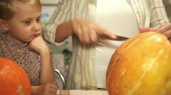 Little Son looks for Mother jack-o-lantern Curving Process Stock Footage