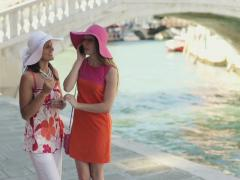 Stock Video Footage of Rich female friends talking on cellphone in Venice