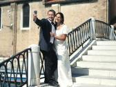 Just married couple taking photo with smartphone on the bridge in Venice Stock Footage