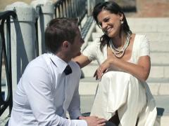Happy just married couple sitting on stairs and talking, Venice - stock footage