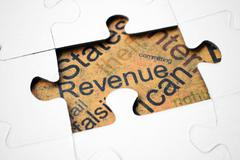 Revenue puzzle concept Stock Photos