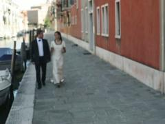 Happy just married couple walking near canal in Venice, slow motion Stock Footage