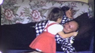 Stock Video Footage of Sleeping GRANDFATHER Hugs Grand Daughter 1950s (Vintage Film Home Movie) 5069