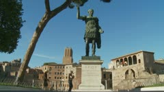 Caesar statue in Rome, tourists walk by Stock Footage