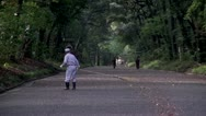 Stock Video Footage of Meiji Shrine Sweeper
