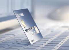 credit card at desktop computer - stock illustration