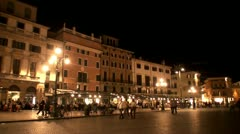 Pan from Piazza Bra to the Arena in Verona at night Stock Footage
