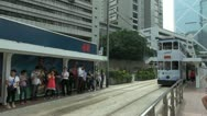 Fast motion of tram traffic, station, Hong Kong, China Stock Footage