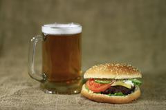 Hamburger and beer Stock Photos