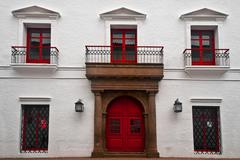 Red and White Colonial Building - stock photo