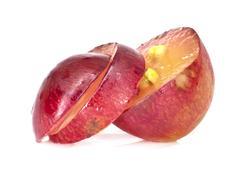 translucent slice of red grape fruit, macro isolated on white - stock photo