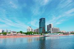 High-rise building on riverbank. urban landscape Stock Photos