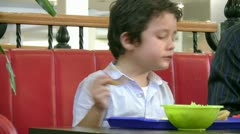 Little boy in fast food restaurant Stock Footage