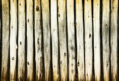 Dilapidated old wooden fence - rural background Stock Photos
