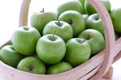 Green granny smith apples in a trug Stock Photos
