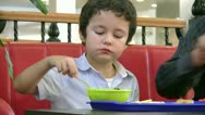 Stock Video Footage of Little boy in fast food restaurant