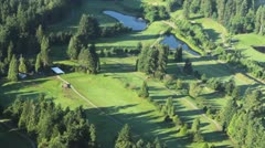 Aerial Perspective of Golf Course on Sunny Day 1 Stock Footage