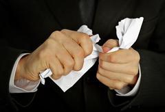 Businessman hands furiously tormenting document Stock Photos