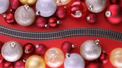 Toy train passing through Christmas tree decorations Stock Footage