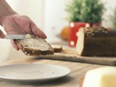 Woman spreading butter on slice of bread NTSC Stock Footage