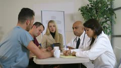 Stock Video Footage of pharmaceutical saleslady having a meeting with doctors