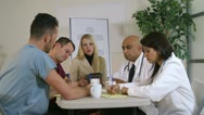 Pharmaceutical saleslady having a meeting with doctors Stock Footage