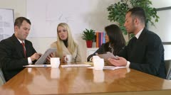 business meeting at a conference table - stock footage