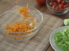 Chopped carrot falling into bowl, slow motion shot at 240fps NTSC Stock Footage
