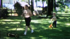 FATHER and SON Mow Lawn Cut Grass Together 1960s Vintage Film Home Movie 5127 Stock Footage