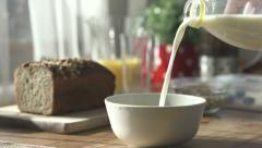 Pouring milk into bowl, slow motion shot at 240fps HD Stock Footage