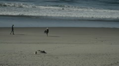 Two people on Beach. Stock Footage