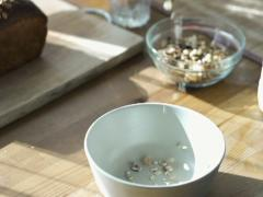 Pouring muesli into bowl, slow motion shot at 240fps NTSC Stock Footage