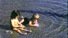 LITTLE KIDS PLAY Shore WATER Fun VACATION 1960s (Vintage Film Home Movie) 5131 Stock Footage