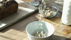 Pouring muesli into bowl HD Stock Footage