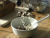 Pouring muesli into bowl NTSC Stock Footage