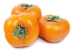three persimmon - stock photo
