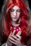 Girl with red apple in a poetic representation Stock Photos