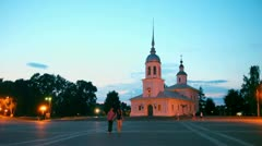 Couple approach by Kremlin square in Vologda, Russia Stock Footage