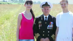 Grandfather in marine uniform stand at middle of couple Stock Footage